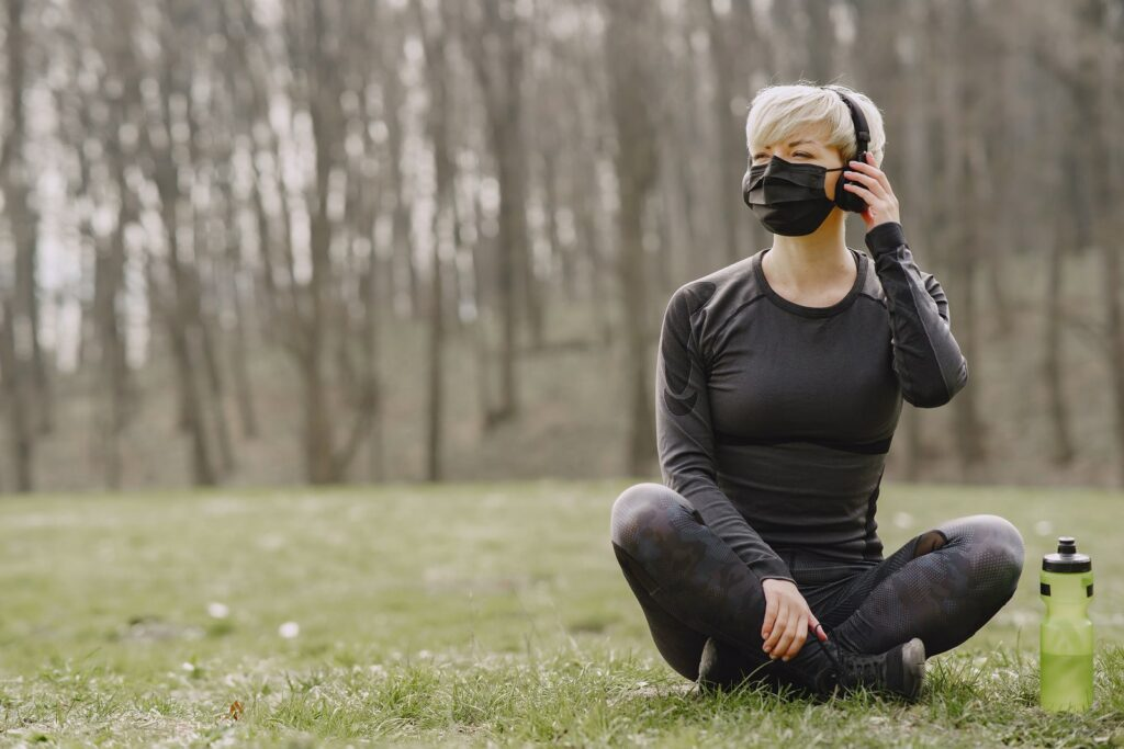 Girl with mask listening to music